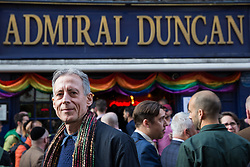 London, UK. 30th April 2019. LGBT and human rights campaigner Peter Tatchell joins survivors of the Admiral Duncan bombing, families and friends of the victims and the LGBTQ community outside the Admiral Duncan pub in Old Compton Street, Soho, to mark 20 years since the attack. Three people were killed and 79 injured when a bomb packed with up to 1,500 four-inch nails was detonated by a neo-Nazi at the Admiral Duncan on 30th April 1999.