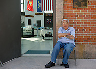East Meadow, New York, USA. May 25, 2019. Marine Veteran ANGELO CIOTTA, who volunteers at the Nassau County Veterans Memorial Museum, sits outside its open entrance during Saturday of Memorial Day Weekend at Eisenhower Park on Long Island. Ciotta, President of Iwo Jima Survivors Association of New York, landed at H+1 hour, one hour after the first wave of Marines landed at Iwo Jima on D-Day, February 19, 1945.