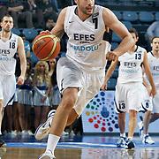 Efes Pilsen's Cenk AKYOL during their Turkish Basketball Legague Play-Off qualifying second match Efes Pilsen between Pinar Karsiyaka at the Sinan Erdem Arena in Istanbul Turkey on Friday 13 May 2011. Photo by TURKPIX
