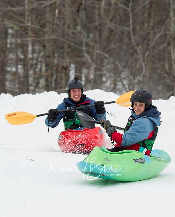 Liam Carvajal and Jonah Bussgang battle down the course during the 3rd annual Boat Bash Snow Crash with Mill City Park at the Veteran's Memorial Ski Hill in Franklin Saturday afternoon.  (Karen Bobotas/for the Laconia Daily Sun)