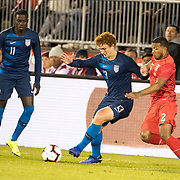 EAST HARTFORD, CONNECTICUT- October 16th:  Josh Sargent #13 of the United States challenged by Johan Madrid #2 of Peru as midfielder Tim Weah #11 of the United States looks on during the United States Vs Peru International Friendly soccer match at Pratt & Whitney Stadium, Rentschler Field on October 16th 2018 in East Hartford, Connecticut. (Photo by Tim Clayton/Corbis via Getty Images)