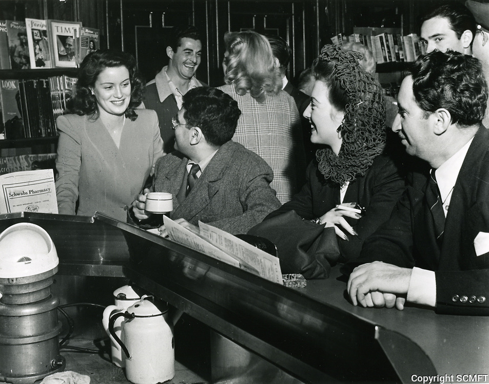 1945 Sidney Skolsky Chats With Fans At Schwab's Drugstore