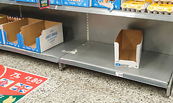 © Licensed to London News Pictures. 25/09/2020. London, UK. An empty shelf and boxes in Morrisons supermarket in north London runs low of Eggs supply amidst a possible second lockdown due to a rise in COVID-19 cases. A number of supermarkets are restricting shoppers from bulk-buying products such as flour, pasta, toilet rolls and anti-bacterial wipes. Photo credit: Dinendra Haria/LNP