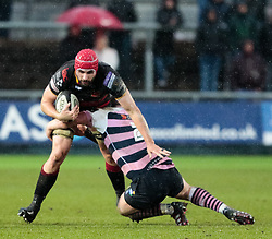 Dragons' Cory Hill is tackled by Cardiff Blues' Matthew Rees<br /> <br /> Photographer Simon King/Replay Images<br /> <br /> Guinness Pro14 Round 11 - Dragons v Cardiff Blues - Tuesday 26th December 2017 - Rodney Parade - Newport<br /> <br /> World Copyright © 2017 Replay Images. All rights reserved. info@replayimages.co.uk - www.replayimages.co.uk