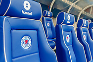 Seats in the dugout display the clubs crest as the teams prepare to come out for the Ladbrokes Scottish Premiership match between Rangers and Aberdeen at Ibrox, Glasgow, Scotland on 27 April 2019.