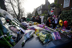 © Licensed to London News Pictures. 28/12/2016. London, UK. Tributes are left on the bonnet of George Michaels car outside his London home in Highgate, North London. Pop superstar George Michael died on Christmas day at his Oxfordshire home on the River Thames aged 53. Photo credit: Ben Cawthra/LNP