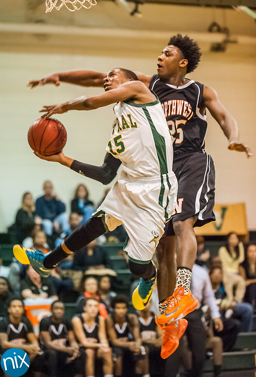 Central Cabarrus' Shalen Thompson goes up for a shot against Northwest Cabarrus' Anthony Caldwell Friday night at Central Cabarrus High School. Central won the game 47-46.