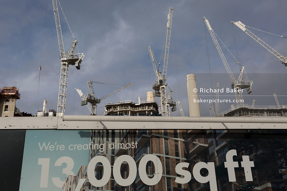 The cranes that tower over the chimneys of Battersea Power Station at Nine Elms, south London, currently the largest construction site in Europe creating 13,000 square feet of residential and retail space, on 27th January 2020, in London, England.