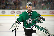 DALLAS, TX - OCTOBER 17:  Dan Ellis #30 of the Dallas Stars stretches during a break against the San Jose Sharks on October 17, 2013 at the American Airlines Center in Dallas, Texas.  (Photo by Cooper Neill/Getty Images) *** Local Caption *** Dan Ellis