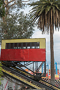 Cable car or funicular, palm tree and harbor in background, Valparasio, Chile