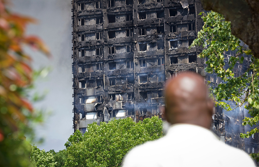 14 June 2017 taken between the hours of 12.22 - 14.49<br /> <br /> The Grenfell Tower fire occurred on 14 June 2017 at the 24-storey, 220-foot-high (67 m), Grenfell Tower block of public housing flats in North Kensington, Royal Borough of Kensington and Chelsea, West London. It caused at least 80 deaths and over 70 injuries. A definitive death toll is not expected until at least 2018. As of 5 July 2017, 21 victims had been formally identified by the Metropolitan Police. Authorities were unable to trace any surviving occupants of 23 of the flats.<br /> <br /> Emergency services received the first report of the fire at 00:54 local time. It burned for about 60 hours until finally extinguished. More than 200 firefighters and 45 fire engines from stations all over London were involved in efforts to control the fire. Many firefighters continued to fight pockets of fire on the higher floors after most of the rest of the building had been gutted. Residents of surrounding buildings were evacuated due to concerns that the tower could collapse, but the building was later determined to be structurally sound.<br /> <br /> The tower contained 129 flats. Police were unable to trace any survivors from 23 of these, and their occupants are believed to have died in the fire. Firefighters rescued 65 people. Seventy-four people were confirmed to be in six hospitals across London, and 17 of them were in a critical condition. The fire started in a fridge-freezer on the fourth floor. The growth of the fire is believed to have been accelerated by the building's exterior cladding.  ( Source Wikipedia}