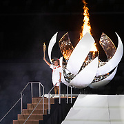 TOKYO, JAPAN - JULY 23: Naomi Osaka of Japan  after lighting the olympic frame at the Opening Ceremony for the Tokyo 2020 Summer Olympic Games at the Olympic Stadium on July 23, 2021 in Tokyo, Japan. (Photo by Tim Clayton/Corbis via Getty Images)