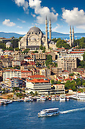 The Suleymaniye Mosque (Süleymaniye Camii, 1550-1558)  on the Third Hill and a ferry boat and the banks of the Golden Horn, Istanbul Turkey. .<br /> <br /> If you prefer to buy from our ALAMY PHOTO LIBRARY  Collection visit : https://www.alamy.com/portfolio/paul-williams-funkystock/istanbul.html<br /> <br /> Visit our TURKEY PHOTO COLLECTIONS for more photos to download or buy as wall art prints https://funkystock.photoshelter.com/gallery-collection/3f-Pictures-of-Turkey-Turkey-Photos-Images-Fotos/C0000U.hJWkZxAbg