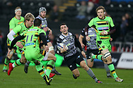 Tom Habberfield of the Ospreys © looks for a gap. European Rugby Champions Cup, pool 2 match, Ospreys v Northampton Saints at the Liberty Stadium in Swansea, South Wales on Sunday 17th December 2017.<br /> pic by  Andrew Orchard, Andrew Orchard sports photography.