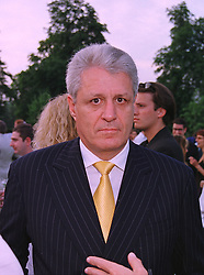 DR GERT-RUDOLF FLICK the German Mercedes car heir, at a party in London on 7th July 1999.MUC 97