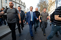 March 29, 2019 - London, UK - Former Leader of UKIP, NIGEL FARAGE (centre), leaves after speaking on stage at a Leave Means Leave demonstration in Westminster on the day that Britain was originally due to leave the European Union. MPs today rejected Theresa May's withdrawal deal for the third time. (Credit Image: © Tom Nicholson/London News Pictures via ZUMA Wire)