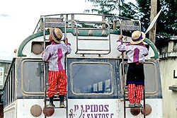 Two Boys On Back Of Bus