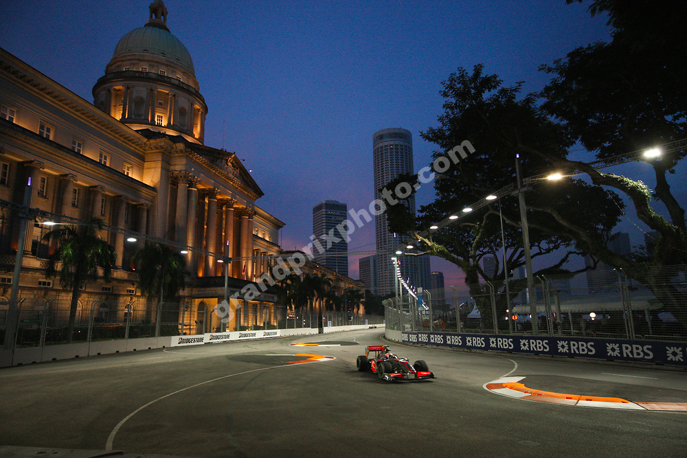 Mclaren - Mercedes  Heikki Kovalainen driving by Singapore City Hall and skyline before the Singapore Grand Prix 2009. Photo: Grand Prix Photo