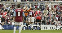 Photo Aidan Ellis.<br /> Burnley v Sunderland.<br /> FA Barclaycard Premiership.<br /> 09/05/2004.<br /> Sunderland's Gary Breen (left) heads the ball in for the eqaulising goal