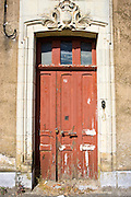 Weathered doorway in Ballee, Normandy, France