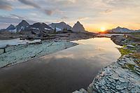 Sunset over Kintla and Kinnerly Peaks seen from Boulder Peak. Glacier National Park Montana