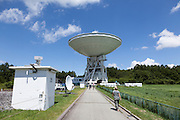 Tourists walk towards the 45 metre radio telescope at Nobeyama Radio Observatory (NRO) near Minamimaki, Nagano, Japan Wednesday August 17th 2016. The NRO is a project run by the National Astronomical Observatory of Japan (NAOJ), and the institute of the National Institute of Natural Sciences (NINS). The site, operates powerful, advanced radio telescopes, including a 45-m Radio Telescope (one of the world's largest),The Nobeyama Radio Polarimeter, and the 6 antenna Nobeyama millimetre array.