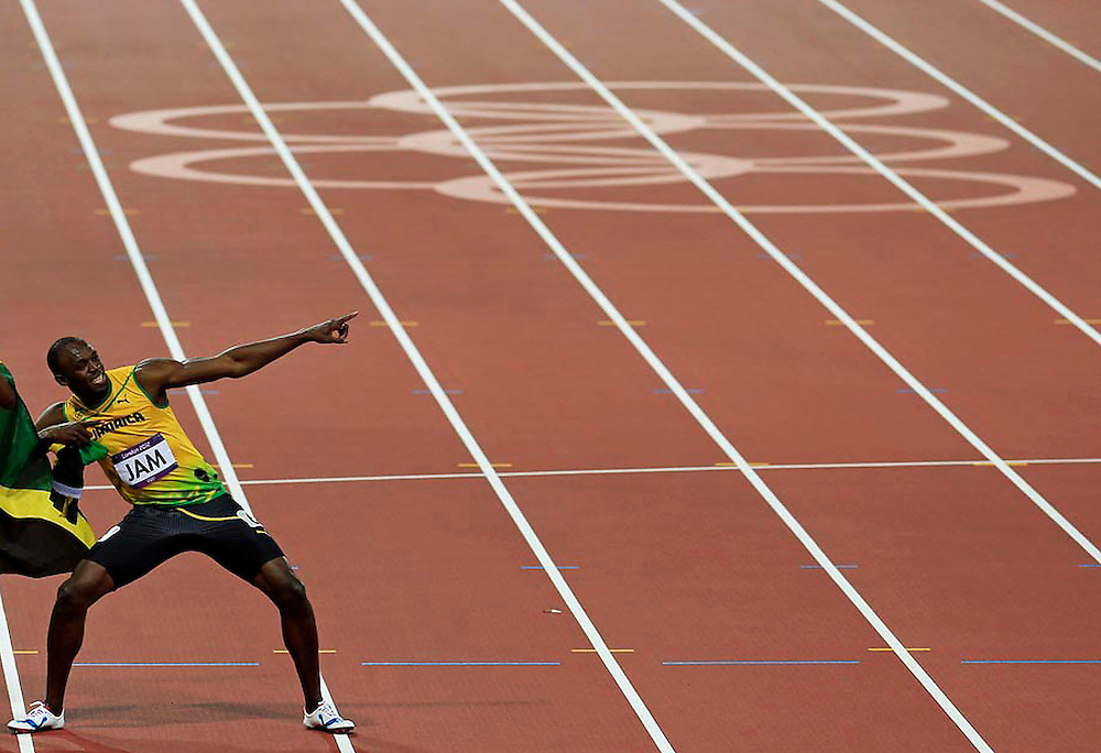 Jamaica's Usain Bolt celebrates winning the men's 4x100m relay final during the London 2012 Olympic Games at the Olympic Stadium August 11, 2012. The Jamaican team set a new world record of 36.84 seconds.   REUTERS/Jim Young