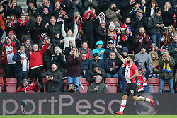 Southampton's Charlie Austin celebrates scoring his side's third goal during the Premier League match at St Mary's, Southampton.