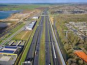 Nederland, Utrecht, Maarssen, 25-02-2020; Rijksweg A2 ter hoogte van Maarssenbroek richting Amsterdam, links van de snelweg bedrijventerrein Haarrijn.<br /> A2 motorway near Maarssenbroek towards Amsterdam, Haarrijn business park motorway.<br /> <br /> luchtfoto (toeslag op standard tarieven);<br /> aerial photo (additional fee required)<br /> copyright © 2020 foto/photo Siebe Swart
