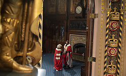Members of the house of Lords wearing their robes and masks talk with each other as they wait to enter their chamber during the State Opening of Parliament in the House of Lords at the Palace of Westminster in London. Picture date: Tuesday May 11, 2021.