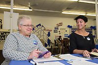 Lynn Thomas and Serena Downes are ready to greet supporters at the Democratic headquarters on Beacon Street West for the Presidential debate on Monday evening.  (Karen Bobotas/for the Laconia Daily Sun)