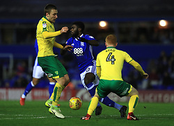 Birmingham City's Jeremie Boga (centre) and Norwich City's Tom Trybull and Harrison Reed battle for the ball