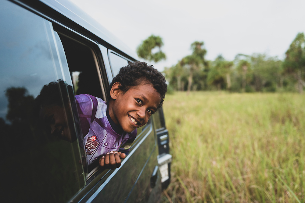 A boy sticks his head out of a vehicle during a visit to the old World War II airfield at Tadji on the outskirts of Aitape in Papua New Guinea.<br /> <br /> (July 19, 2017)