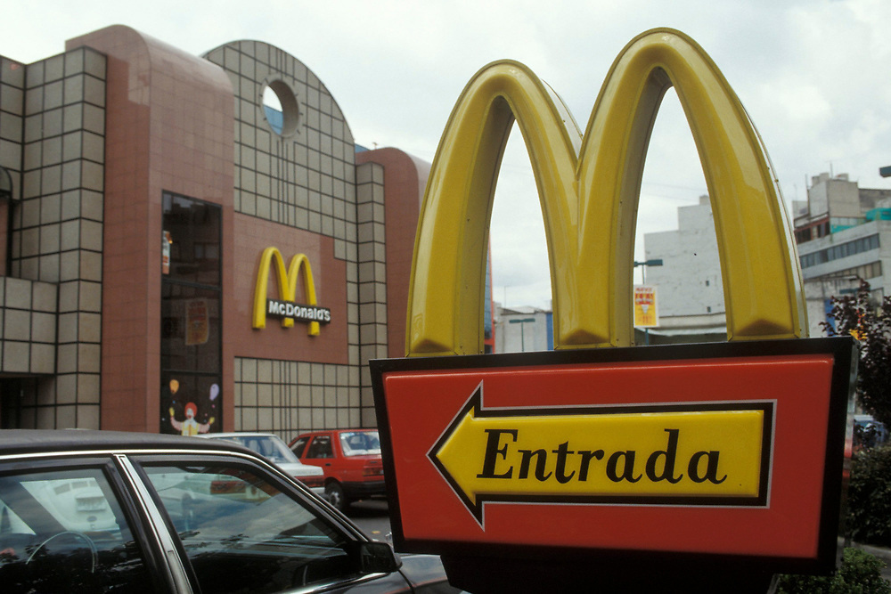 Facade and sign of modern McDonald's fast food restuarant in Mexico City. c1980s<br /> ©Bob Daemmrich