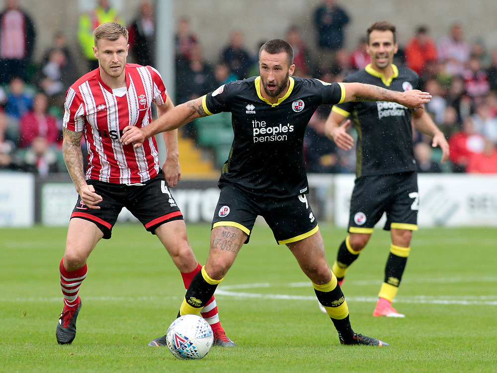 Crawley Town's Ollie Palmer shields possession from Lincoln City's Michael O'Connor<br /> <br /> Photographer David Shipman/CameraSport<br /> <br /> The EFL Sky Bet League Two - Lincoln City v Crawley Town - Saturday September 8th 2018 - Sincil Bank - Lincoln<br /> <br /> World Copyright © 2018 CameraSport. All rights reserved. 43 Linden Ave. Countesthorpe. Leicester. England. LE8 5PG - Tel: +44 (0) 116 277 4147 - admin@camerasport.com - www.camerasport.com