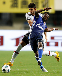 ZHUHAI, July 19, 2017 Bernard Tekpetey (R) of FC Schalke 04 vies for the ball during a pre-season soccer match between Bundesliga's FC Schalke 04 and Turkish Super League champion Besiktas JK at Zhuhai Sports Center Stadium in Zhuhai, south China's Guangdong Province, July 19, 2017. FC Schalke 04 won 3-2. (Credit Image: © Wang Lili/Xinhua via ZUMA Wire)