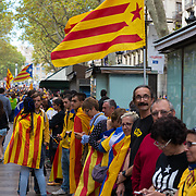 Line of people in Barcelona at National Day of Catalonia, Spain
