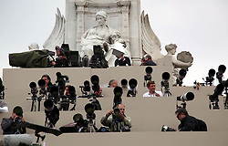 29 April 2011. London, England..Royal wedding day. Press photographers wrap up for the day in their custom built stands outside Buckingham Palace..Photo; Charlie Varley.