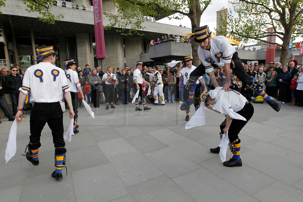 © Licensed to London News Pictures. 12/05/2012, London, UK.  Hammersmith Morris Men dance at the South Bank by the National Theatre in London as Morris men from around the country gather in London for a Westminster Morris Men Day of Dance, Saturday, May 12, 2012. Photo credit : Sang Tan/LNP