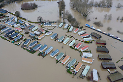 © Licensed to London News Pictures. 22/12/2019. Yalding, UK. Boats are moored on the river Medway (R) as flood water has inundated the Little Venice caravan park near Yalding in Kent after the River Medway burst its banks. River levels remain high after a second night of heavy rain in the south. More rain is expected today. Photo credit: Peter Macdiarmid/LNP