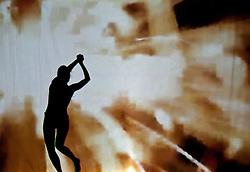 05.05.2011, Ferry Porsche CONGRESS CENTER, Zell am See, AUT, IRONMAN 70.3 Salzburg, im Bild eine weibliche Silhouette beim tanzen, gold Schattenspiele während der Präsentations- Pressekonferenz des Ironman 70.3 Zell am See Kaprun, der am 26. August 2012 erstmals über die Bühne geht // a female silhouette dancing, gold, EXPA Pictures © 2011, PhotoCredit: EXPA/ J. Feichter