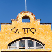 The front of a stucco facade building in downtown Playa del Carmen on Mexico's Yucatana Peninsula.