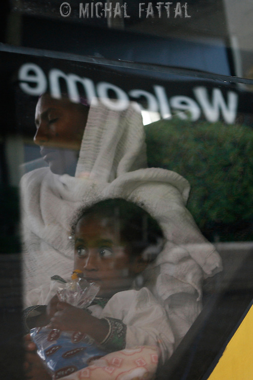 Newly arrived Ethiopian mother and son, as they get along with the rest of the group, to the Ben Gurion international airport in Israel, June 2008.