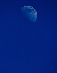 The International Space Station passes near the Moon.