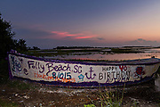 The Folly Boat a landmark public art project along the marsh at sunset in Folly Beach, SC.