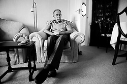 © Licensed to London News Pictures. 09/04/2014<br /> These photographs have been converted to black and white<br /> <br /> Durham, United Kingdom<br /> <br /> Parkinson's Disease sufferer David Forsyth from Brandon, County Durham sits in his armchair at the bungalow he shares with his wife Judy as he waits for her to bring him his medication.<br /> <br /> Parkinson's is a long-term neurological condition that affects the way the brain co-ordinates body movements including walking, talking and writing and affects both men and women.<br /> <br /> Photo credit : Ian Forsyth/LNP