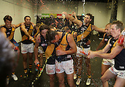 Ben Lennon and Matt McDonough of the Tigers are sprayed in the rooms after  the 2014 AFL Round 10 match between the GWS Giants and the Richmond Tigers at Spotless Stadium, Sydney on May 24, 2014. (Photo: Craig Golding/AFL Media)