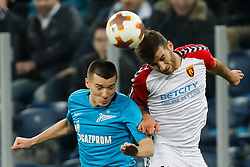 November 23, 2017 - Saint Petersburg, Russia - Dmitri Poloz (L) of FC Zenit Saint Petersburg and Hovhannes Hambartsumyan of FK Vardar vie for a header during the UEFA Europa League Group L match between FC Zenit St. Petersburg and FK Vardar at Saint Petersburg Stadium on November 23, 2017 in Saint Petersburg, Russia. (Credit Image: © Mike Kireev/NurPhoto via ZUMA Press)
