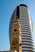 High rise modern building and old turret in Downtown Haifa, Israel.