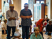 06 JULY 2016 - BANGKOK, THAILAND:  Men pray in Ton Son Mosque in the Thonburi section of Bangkok before Eid services. Eid al-Fitr is also called Feast of Breaking the Fast, the Sugar Feast, Bayram (Bajram), the Sweet Festival or Hari Raya Puasa and the Lesser Eid. It is an important Muslim religious holiday that marks the end of Ramadan, the Islamic holy month of fasting. Muslims are not allowed to fast on Eid. The holiday celebrates the conclusion of the 29 or 30 days of dawn-to-sunset fasting Muslims do during the month of Ramadan. Islam is the second largest religion in Thailand. Government sources say about 5% of Thais are Muslim, many in the Muslim community say the number is closer to 10%.       PHOTO BY JACK KURTZ